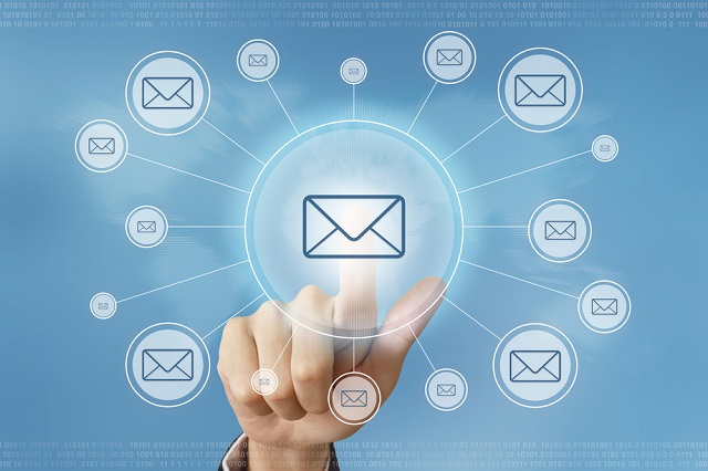 business hand pushing e-mail button with global networking concept
